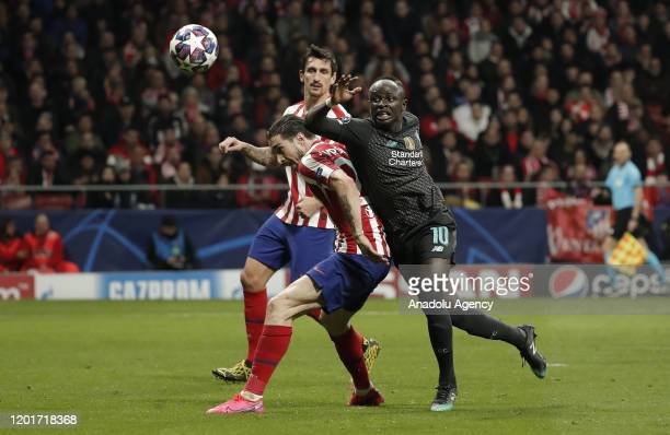 Koke of Atletico Madrid and Sadio Mane of Liverpool vie for the ball during the UEFA Champions League round of 16 first leg soccer match between...