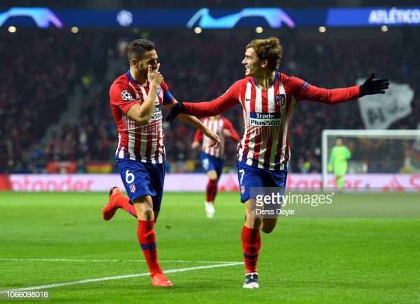 Koke of Atletico Madrid celebrates after scoring his team's first goal with Antoine Griezmann of Atletico Madrid during the UEFA Champions League...
