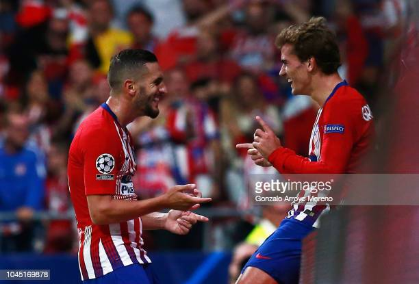 Koke of Atletico Madrid celebrates after scoring his team's third goal with teammate Antoine Griezmann during the Group A match of the UEFA Champions...
