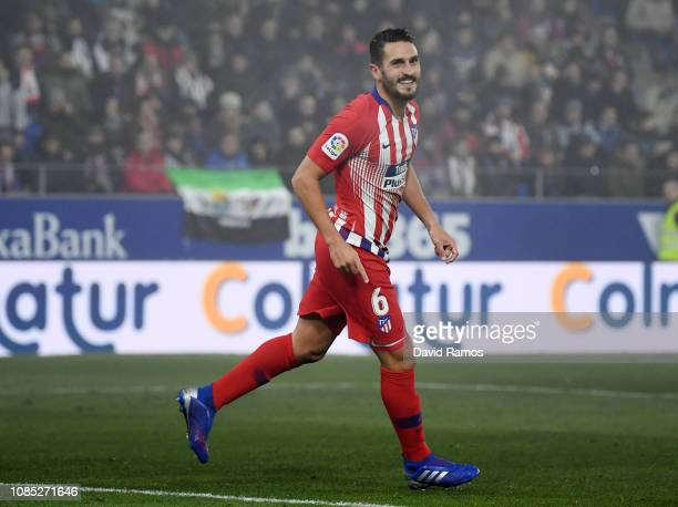 Koke of Atletico Madrid celebrates after scoring his team's third goal during the La Liga match between SD Huesca and Club Atletico de Madrid at...