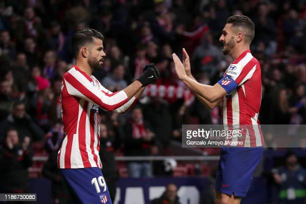 Koke of Atletico Madrid celebrates after scoring his team's third goal with teammate Diego Costa during the La Liga match between Club Atletico de...
