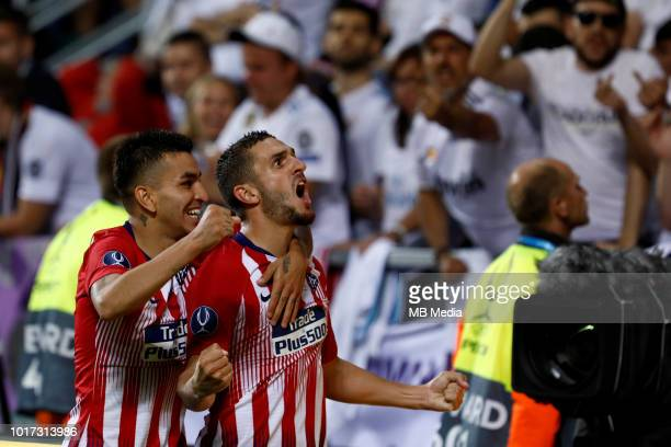 Koke of Atletico Madrid celebrates his goal with teammate Angel Correa during the UEFA Super Cup match between Real Madrid and Atletico Madrid at...