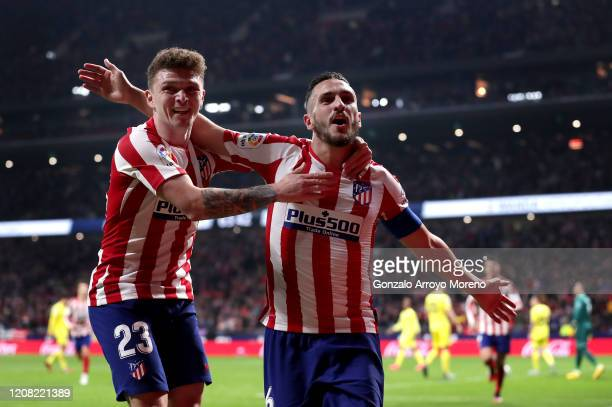 Koke of Atletico Madrid celebrates with teammate Kieran Trippier after scoring his team's second goal during the La Liga match between Club Atletico...