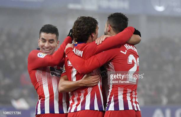 Koke of Atletico Madrid celebrates with teammates after scoring his team's third goal during the La Liga match between SD Huesca and Club Atletico de...