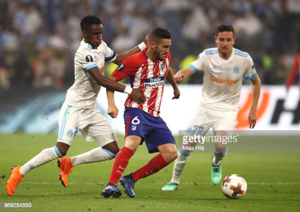 Koke of Atletico Madrid holds off pressure from Bouna Sarr of Marseille during the UEFA Europa League Final between Olympique de Marseille and Club...