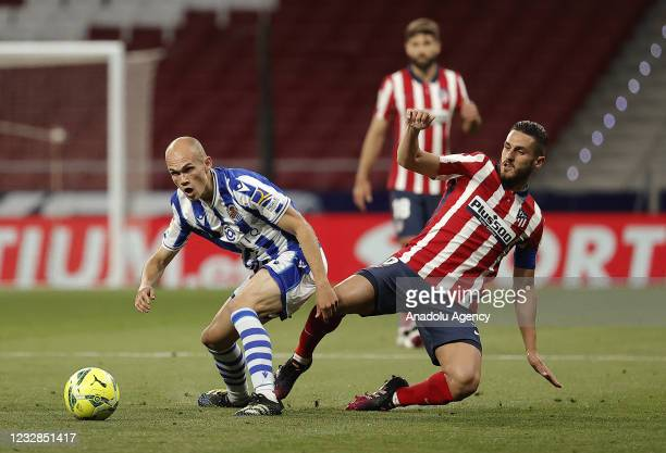 Koke of Atletico Madrid in action against Jon Guridi of Real Sociedad during the La Liga week 36 soccer match between Atletico Madrid and Real...