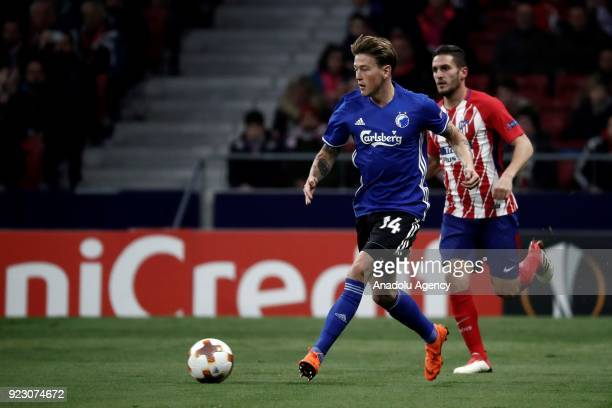 Koke of Atletico Madrid in action against Nicolaj Thomsen of FC Copenhagen during the UEFA Europa League Round of 32 second leg soccer match between...