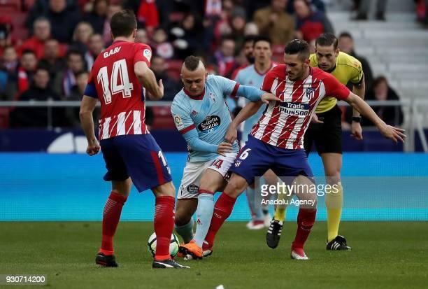 Koke of Atletico Madrid in action against Stanislav Lobotka of Celta Vigo during the La Liga soccer match between Atletico Madrid and Celta Vigo at...