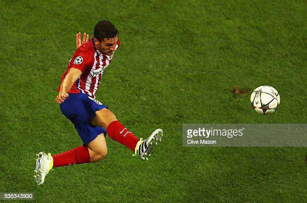 Koke of Atletico Madrid jumps for the ball during the UEFA Champions League Final match between Real Madrid and Club Atletico de Madrid at Stadio...
