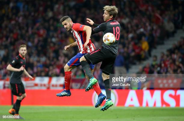 Koke of Atletico Madrid Nacho Monreal of Arsenal during the UEFA Europa League Semi Final second leg match between Atletico Madrid and Arsenal FC at...