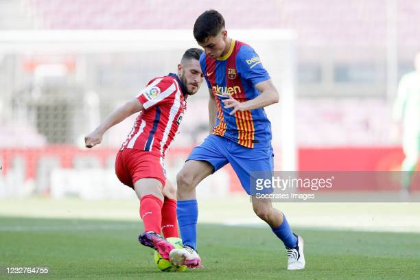 Koke of Atletico Madrid, Pedri of FC Barcelona during the La Liga Santander match between FC Barcelona v Atletico Madrid at the Camp Nou on May 8,...