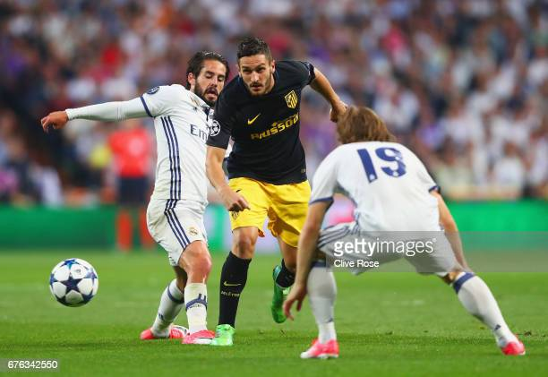 Koke of Atletico Madrid takes on Isco and Luka Modric of Real Madrid during the UEFA Champions League semi final first leg match between Real Madrid...