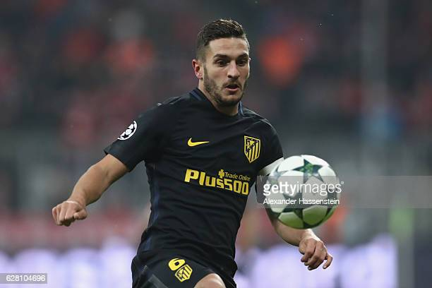 Koke of Atletico runs with the ball during the UEFA Champions League match between FC Bayern Muenchen and Club Atletico de Madrid at Allianz Arena on...