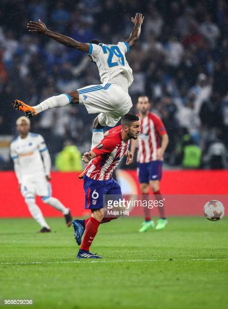 Koke of Atlético Madrid and AndreFrank Zambo Anguissa of Marseille jump for the ball during the UEFA Europa League Final between Olympique de...