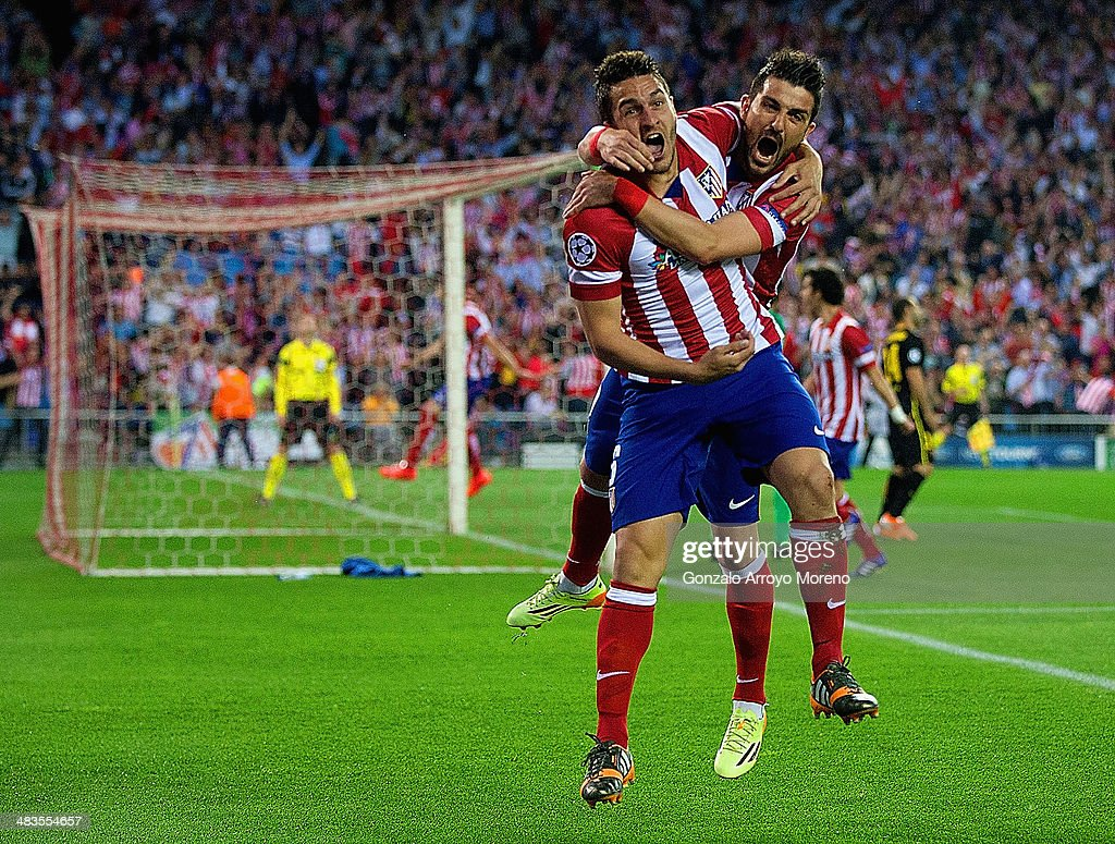 Koke of Club Atletico de Madrid celebrates scoring the opening goal with David Villa of Club Atletico de Madrid during the UEFA Champions League Quarter Final second leg match between Club Atletico de Madrid and FC Barcelona at Vicente Calderon Stadium on April 9, 2014 in Madrid, Spain.