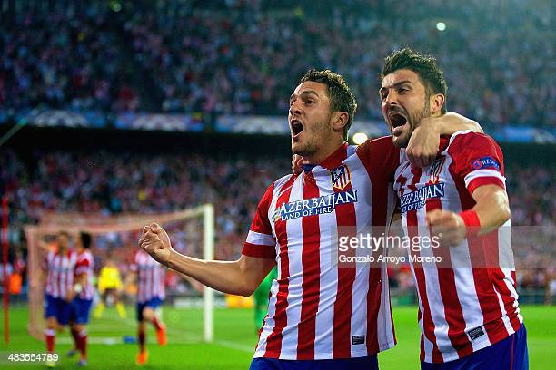 Koke of Club Atletico de Madrid celebrates scoring the opening goal with David Villa of Club Atletico de Madrid during the UEFA Champions League...