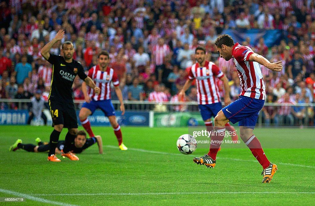 Koke of Club Atletico de Madrid scores the opening goal uring the UEFA Champions League Quarter Final second leg match between Club Atletico de Madrid and FC Barcelona at Vicente Calderon Stadium on April 9, 2014 in Madrid, Spain.