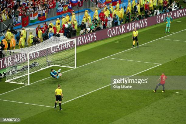 Koke of Spain misses his team's third penalty saved by Igor Akinfeev of Russia in the penalty shoot out during the 2018 FIFA World Cup Russia Round...