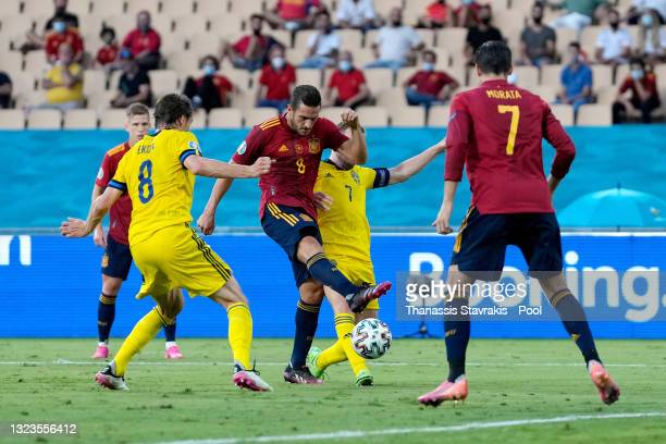 Koke of Spain shoots whilst under pressure from Albin Ekdal and Sebastian Larsson of Sweden during the UEFA Euro 2020 Championship Group E match...