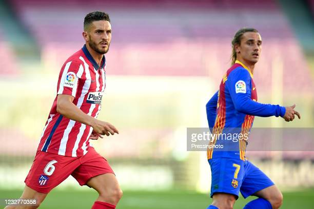 Koke Resurreccion of Atletico de Madrid and Antoine Griezmann of FC Barcelona during the La Liga match between FC Barcelona and Atletico de Madrid...