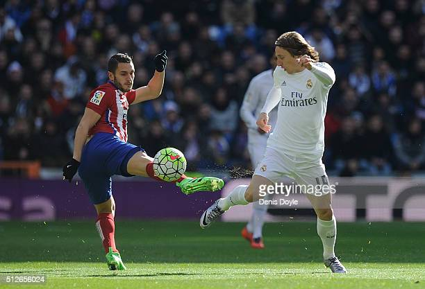 Koke Resurreccion of Club Atletico de Madrid clashes with Luka Modric of Real Madrid during the La Liga match between Real Madrid CF and Club...