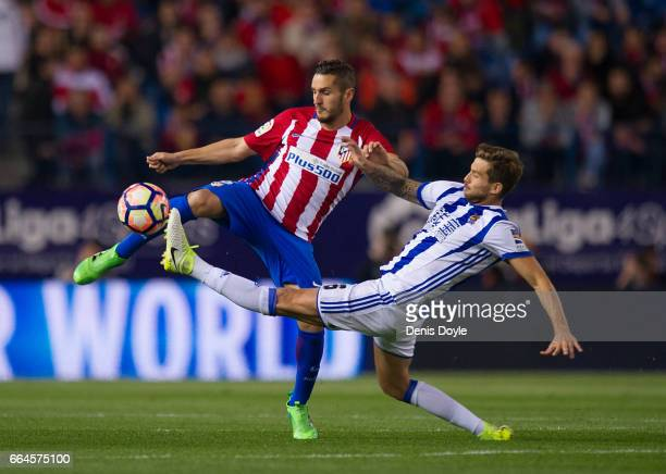 Koke Resurreccion of Club Atletico de Madrid in action against Inigo Martinez of Real Sociedad de Futbol during the La Liga match between Club...