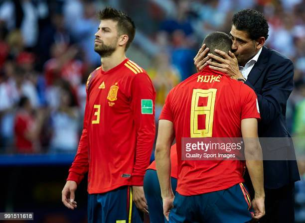 Koke Resurreccion of Spain is consoled by Fernando Hierro head coach and manager of Spain after the 2018 FIFA World Cup Russia Round of 16 match...
