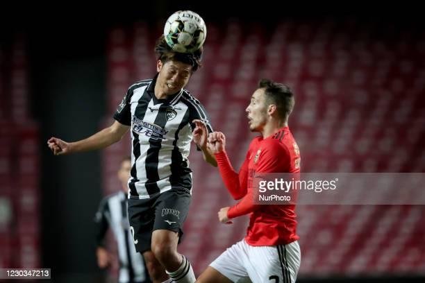 Koki Anzai of Portimonense SC vies with Alejandro Grimaldo of SL Benfica during the Portuguese League football match between SL Benfica and...