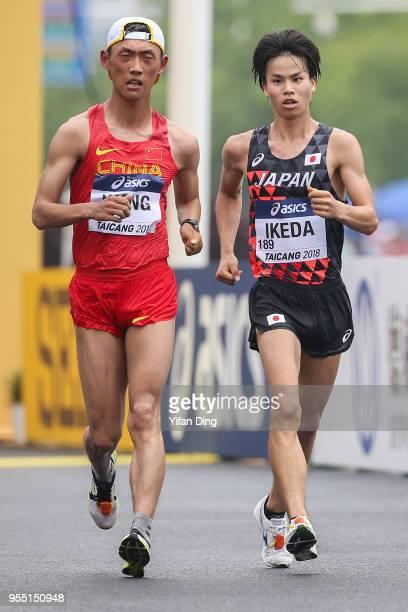 Koki Ikeda of Japan and Wang Kaihua of China in action during Men's 20 kilometres Race Walk of IAAF World Race Walking Team Championships Taicang...