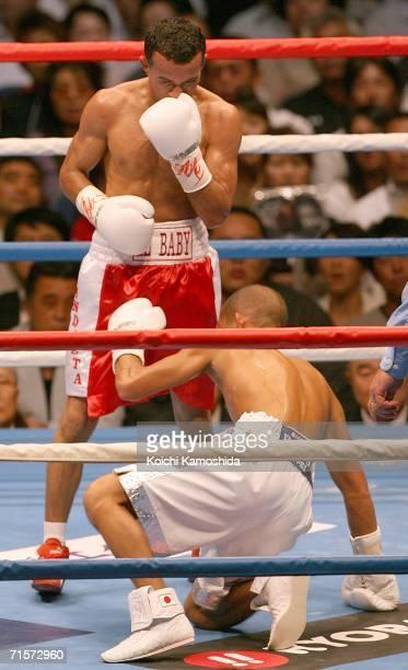 Koki Kameda of Japan is knocked down by Juan Jose Landaeta of Venezuela during World Boxing Association light flyweight title bout at Yokohama Arena...