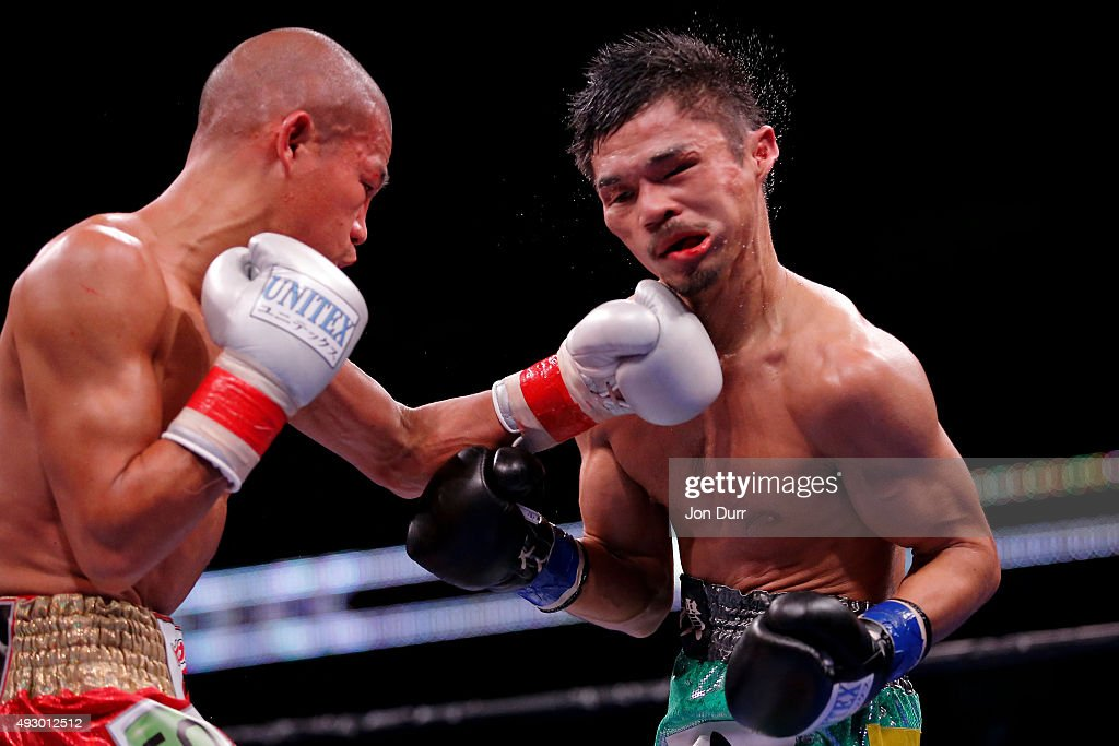 Koki Kameda (L) throws a left at Kohei Kono (R) during their Main Event: Light Heavyweights fight at UIC Pavilion on October 16, 2015 in Chicago, Illinois. Kohei Kono won by unanimous decision.