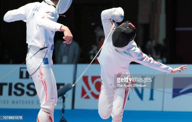 Koki Kano of Japan and Kazuyasu Minobe of Japan compete in the Fencing Men's Epee Individual quarter final at Jakarta Convention Center on day one of...