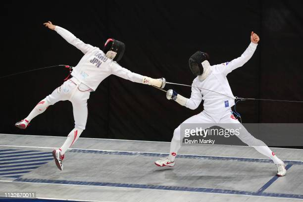 Koki Kano of Japan fences Michele Niggeler of Switzerland during the gold medal match of the team competition at the Men's Epee World Cup on March 24...