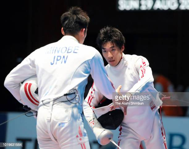 Koki Kano of Japan shakes hands with Kazuyasu Minobe of Japan after his victory in the Fencing Men's Epee Individual quarter final at Jakarta...