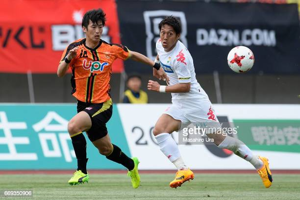 Koki Kiyotake of JEF United Chiba and Yuki Kagawa of Renofa Yamaguchi compete for the ball during the JLeague J2 match between Renofa Yamaguchi and...
