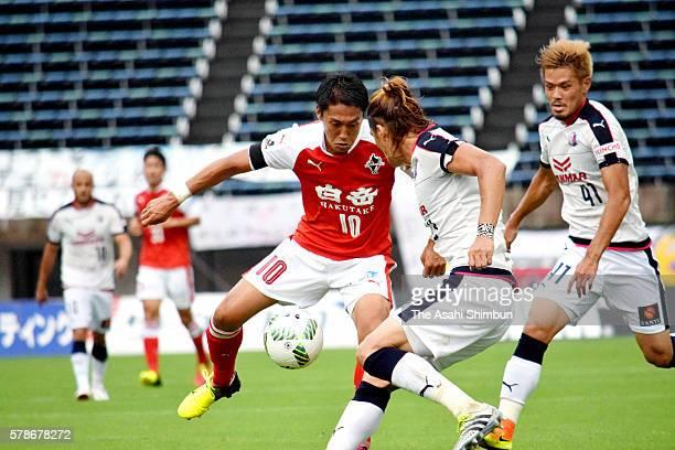 Koki Kiyotake of Roasso Kumamoto and Tatsuya Yamashita of Cerezo Osaka compete for the ball during the J.League second division match between Roasso...
