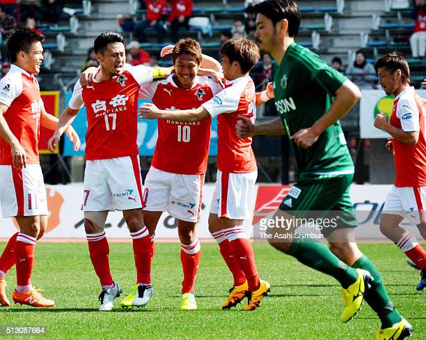 Koki Kiyotake of Roasso Kumamoto celebrates scoring his team's first goal with his team mates during the J.League second division match between...