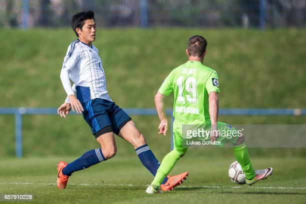 Koki Machida of Japan and Nico Klotz of Duisburg in action during a Friendly Match between MSV Duisburg and the U20 Japan on March 26 2017 in...
