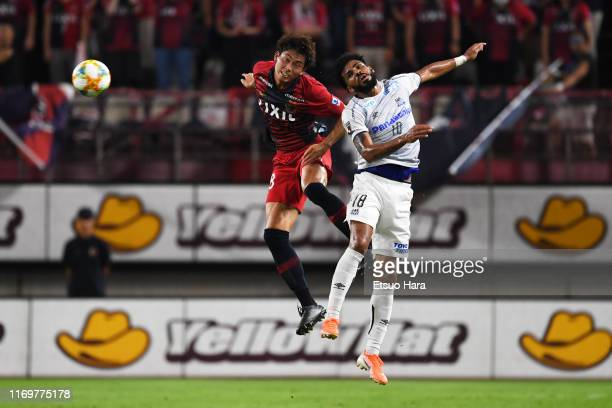 Koki Machida of Kashima Antlers and Patric of Gamba Osaka compete for the ball during the J.League J1 match between Kashima Antlers and Gamba Osaka...