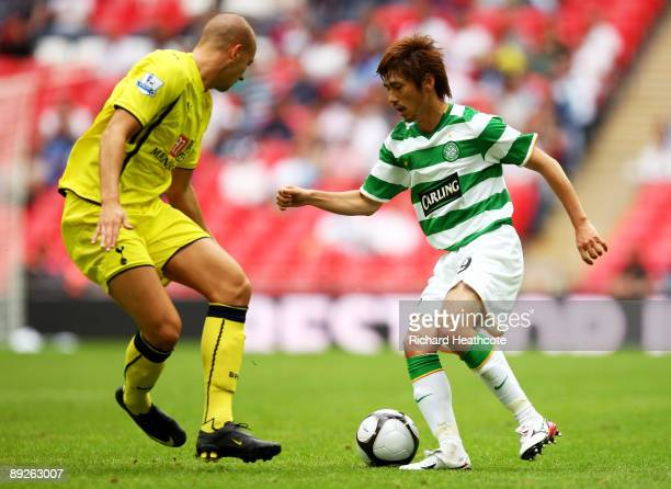 Koki Mizuno of Celtic is challenged by Alan Hutton of Spurs during the Wembley Cup match between Celtic and Tottenham Hotspur at Wembley Stadium on...