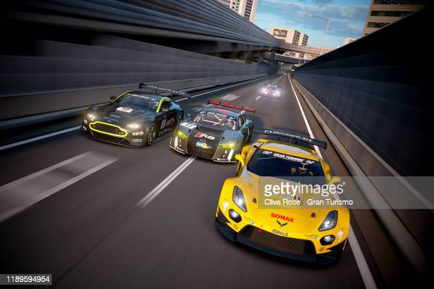 Koki Mizuno of Japan and Team Chevrolet leads Martin Grady of Great Britain and Team Audi and Fabian Portilla of Chile and Team Aston Martin in the...