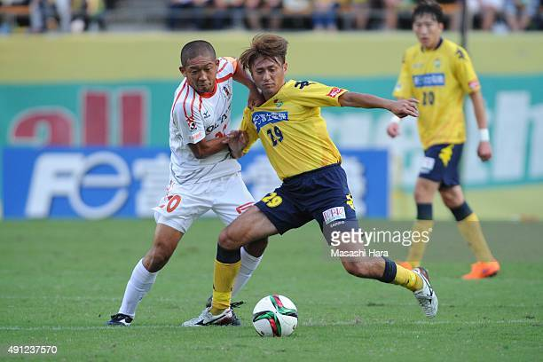 Koki Mizuno of JEF United Chiba and Kazuhisa Kawahara of Ehime FC compete for the ball during the JLeague Division2 match between JEF United Chiba...