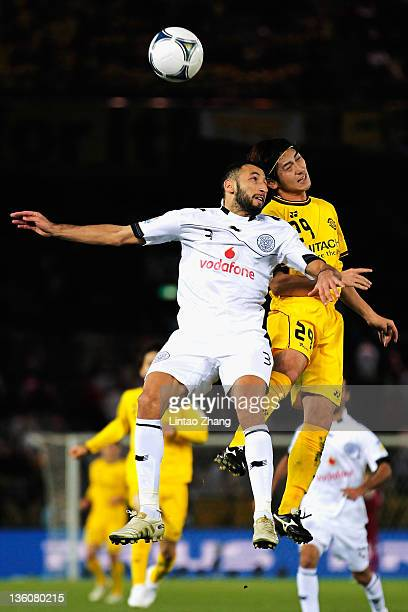 Koki Mizuno of Kashiwa Reysol competes for an aerial ball with Nadir Belhadj of Al Sadd during the FIFA Club World Cup 3rd place match between...