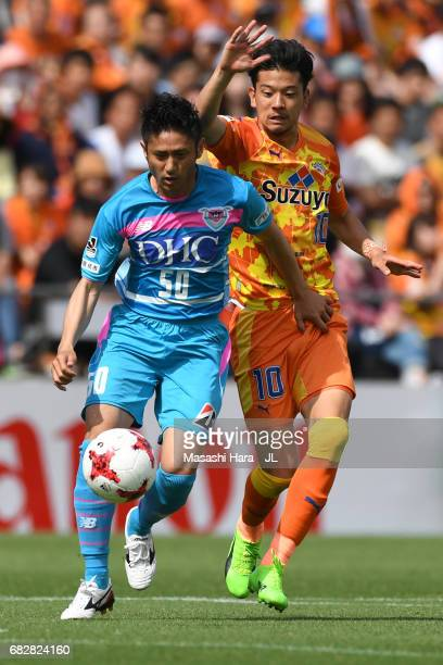Koki Mizuno of Sagan Tosu and Ryohei Shirasaki of Shimizu SPulse compete for the ball during the JLeague J1 match between Shimizu SPulse and Sagan...