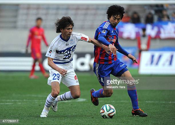 Koki Mizuno of Ventforet Kofu and Hideto Takahashi of FC tokyo compete for the ball during the JLeague match between FC Tokyo vs Ventforet Kofu at...