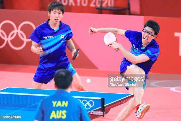 Koki Niwa and Jun Mizutani of Team Japan compete in the doubles match against Heming Hu and Xin Yan of Australia during the Men's Team Round of 16 on...