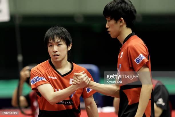 Koki Niwa and Maharu Yoshimura of Japan celebrate after winning the Men's Doubles semi final match against Masataka Morizono and Yuya Oshima of Japan...