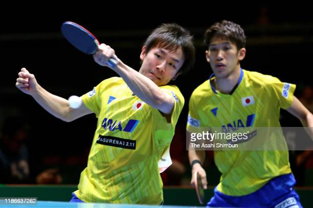 Koki Niwa and Maharu Yoshimura of Japan compete against Liang Jingkun and Xu Xin of China during Men's semi final between Japan and China on day four...