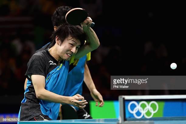 Koki Niwa and Maharu Yoshimura of Japan compete during the Men's Table Tennis gold medal match against Xin Xu and Jike Zhang of China at Riocentro -...