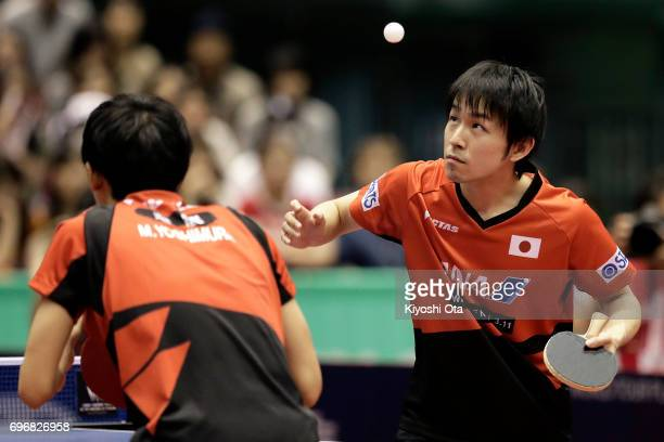 Koki Niwa and Maharu Yoshimura of Japan compete in the Men's Doubles semi final match against Masataka Morizono and Yuya Oshima of Japan during day...